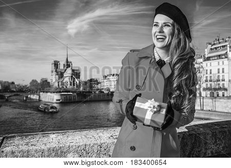 Tourist Woman With Christmas Present Box Looking Into The Distance