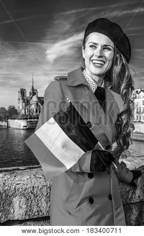 Smiling Woman In Paris With French Flag Looking Into The Distance