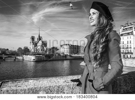 Tourist Woman In Red Trench Coat In Paris, France Looking Aside