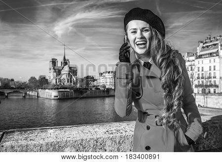 Tourist Woman On Embankment In Paris Talking On A Cell Phone