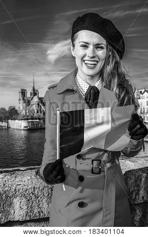 Woman On Embankment Near Notre Dame De Paris Showing Flag