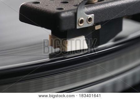 old fashioned turntable player with black vinyl