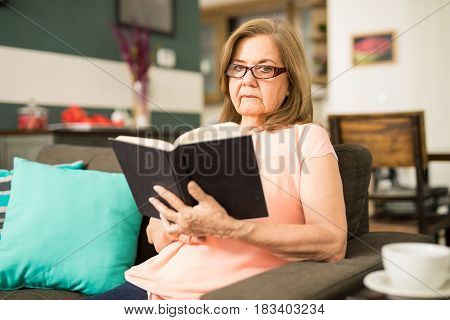 Serious Woman Holding A Book