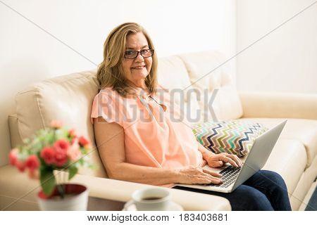 Elder Woman Sending An Email