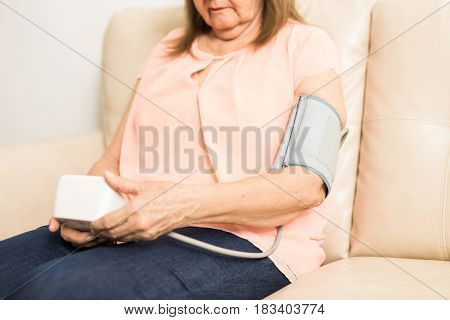Sick Aged Woman Wearing Pressure Gauge