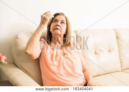 Elder Woman Using Some Eye Drops