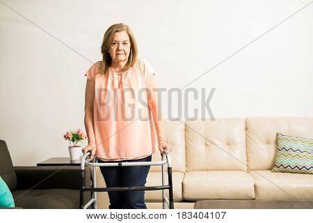 Old Lady Using An Elderly Walker