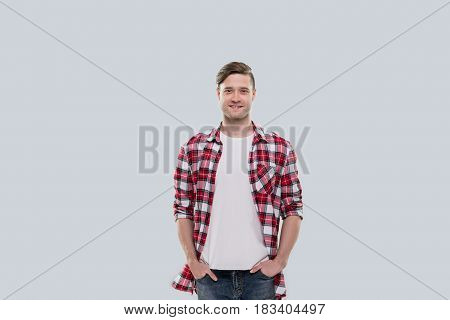 Casual Man Happy Smile Young Handsome Guy Hands In Pocket Wear Checked Shirt Isolated Over Grey Background