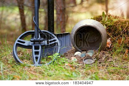 Search for treasure with a metal detector and shovel in the forest.