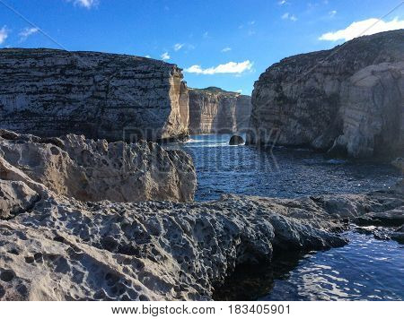 Fungus Rock in the Dwejra Bay using as Background on Wallpaper Gozo Malta
