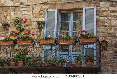 Flowered balcony in the historic center of Todi