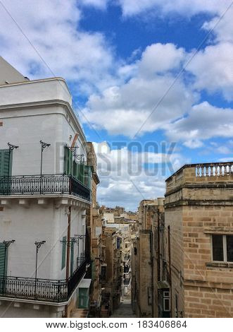 The view of the narrow streets of Valletta with the typical maltese balcony Valletta Malta