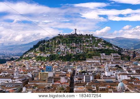 View of the historic center of Quito Ecuador as with Panecillo hill rising in the background