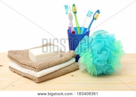 soap with bath towel and wisp of bast on wood background