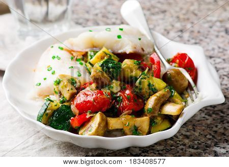 Steamed fish with Vegetables in white plate.selective focus