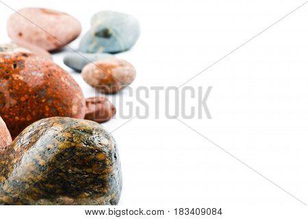 Motley wet sea stones isolated on white background