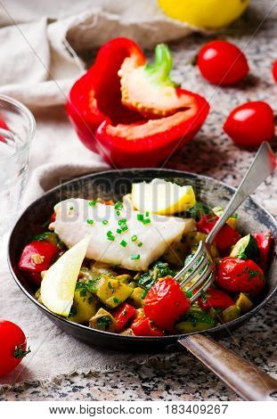 Steamed fish with Vegetables in frying pan.selective focus