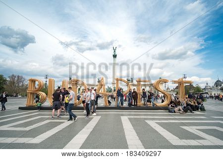 Budapest Hungary - 16 April 2017 : People at Heroes' Square one of the major squares in Budapest Hungary noted for its iconic statue complex featuring the Seven Chieftains of the Magyars