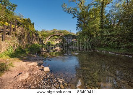 Medieval bridge over Miera river in Lierganes Cantabria Spain.