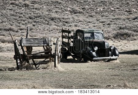 Wreck of cart and pick up in the ghost town of Bodie - California