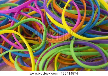 This is a photograph of a pile of Neon Colored elastic rubber bands