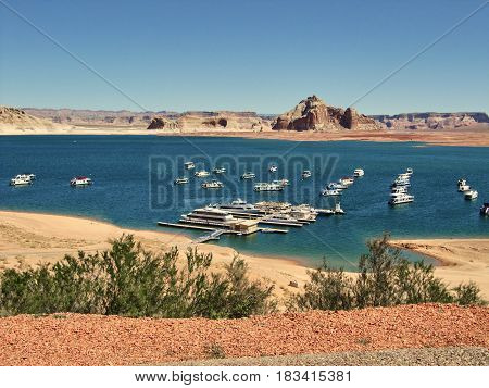 The Lake Powell with typical houseboats .