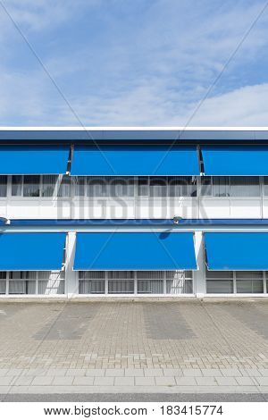 small office building with blue sun shades