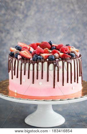 Delicious Homemade Cake Decorated With Chocolate And  Fresh Berries