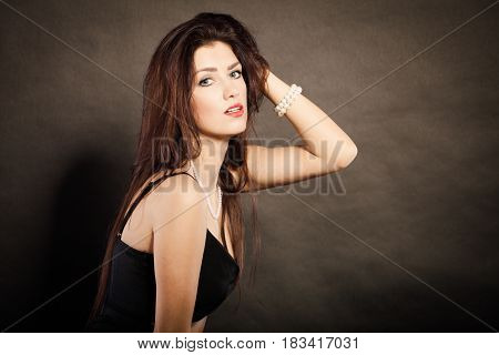 Magnificent long hair woman red lipstick black dress portrait on dark