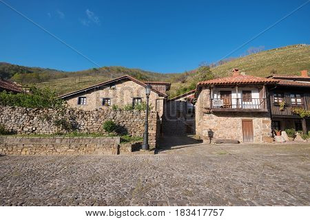 Barcena Mayor village typical stone houses in Cantabria Spain.