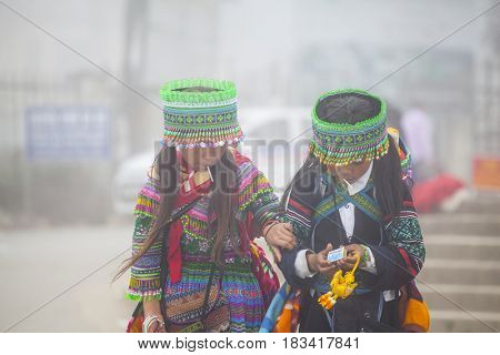 Sa Pa, Vietnam - 15 March, 2017: Ethnic minority,Flower  Hmong girls playing in the marke in Sapa, Vietnam
