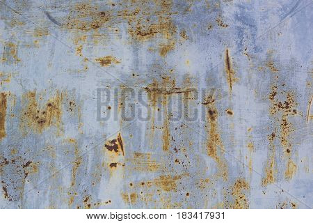 Corroded metal background. Rusted painted metal wall corrosion with streaks of rust