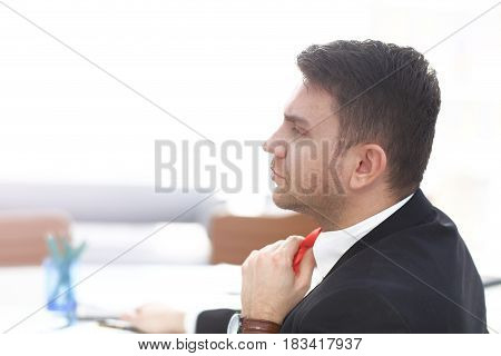 Businessman Adjust Necktie his Suit in light modern office