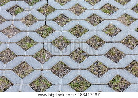 Concrete Pavement Sidewalk Texture With Green Grass And Stones Inside