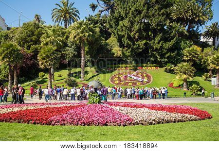 VINA DEL MAR CHILE - OCTOBER 26 2016: Tourists looking at the flower clock (Reloj de Flores). Appeared in 1962 this structure became one of the main landmarks of the city.
