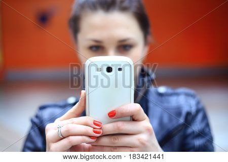 Woman using smart phone mobile to make photo