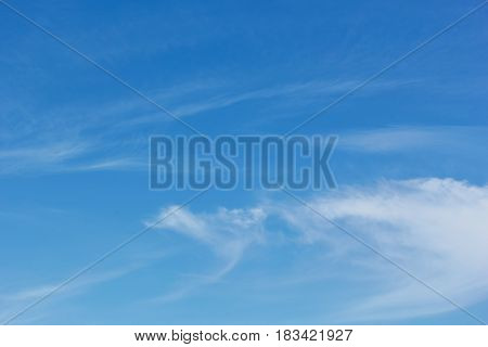 Blue sky with arabesques of white cirrus clouds