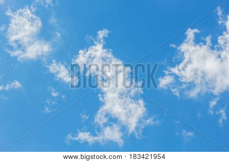 Light white translucent shreds of clouds in the blue sky