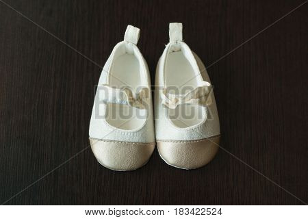 Beautiful original children`s shoes for a small child of white color