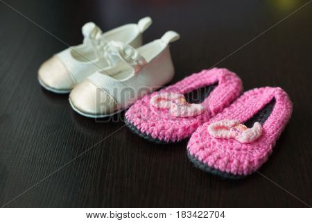 Beautiful original children's shoes for a small child from textiles