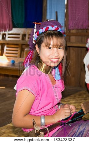 INLE, MYANMAR-MARCH, 2017. Portrait of Kayan Lahwi tribe woman with brass rings on her neck in handicraft shop of Kayan people at one of Inle Lake village on March, 2017.