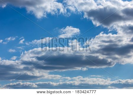 Puffy White And Gray Clouds In A Dark Blue Sky. Texture And Backgrounds.