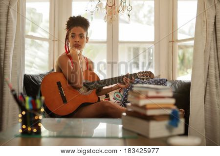 Woman Playing Classic Guitar Composing Music In Her Room