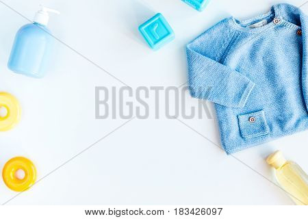 children flat lay with clothes on white desk background top view space for text