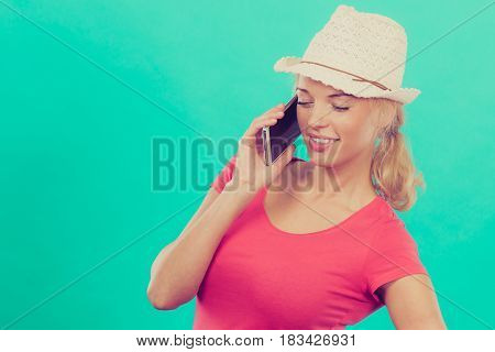 International calls calling friends and family abroad modern technology concept. Tourist woman with sun hat talking on phone