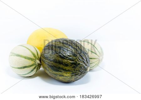 Three Varieties If Melon. Canary, Santa Claus And Charentais Melons Isolated On White Background