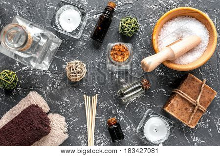 spa composition for body care with sea salt on wooden background top view