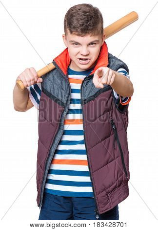 Portrait of a angry teen boy holding a baseball bat and pointing finger to you. Funny hooligan child looking at camera choosing you, isolated on white background.