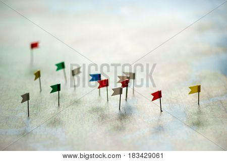 pins of flags on the world map