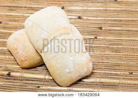 Two Ciabatta Bread On A Bamboo Rustic Placemat